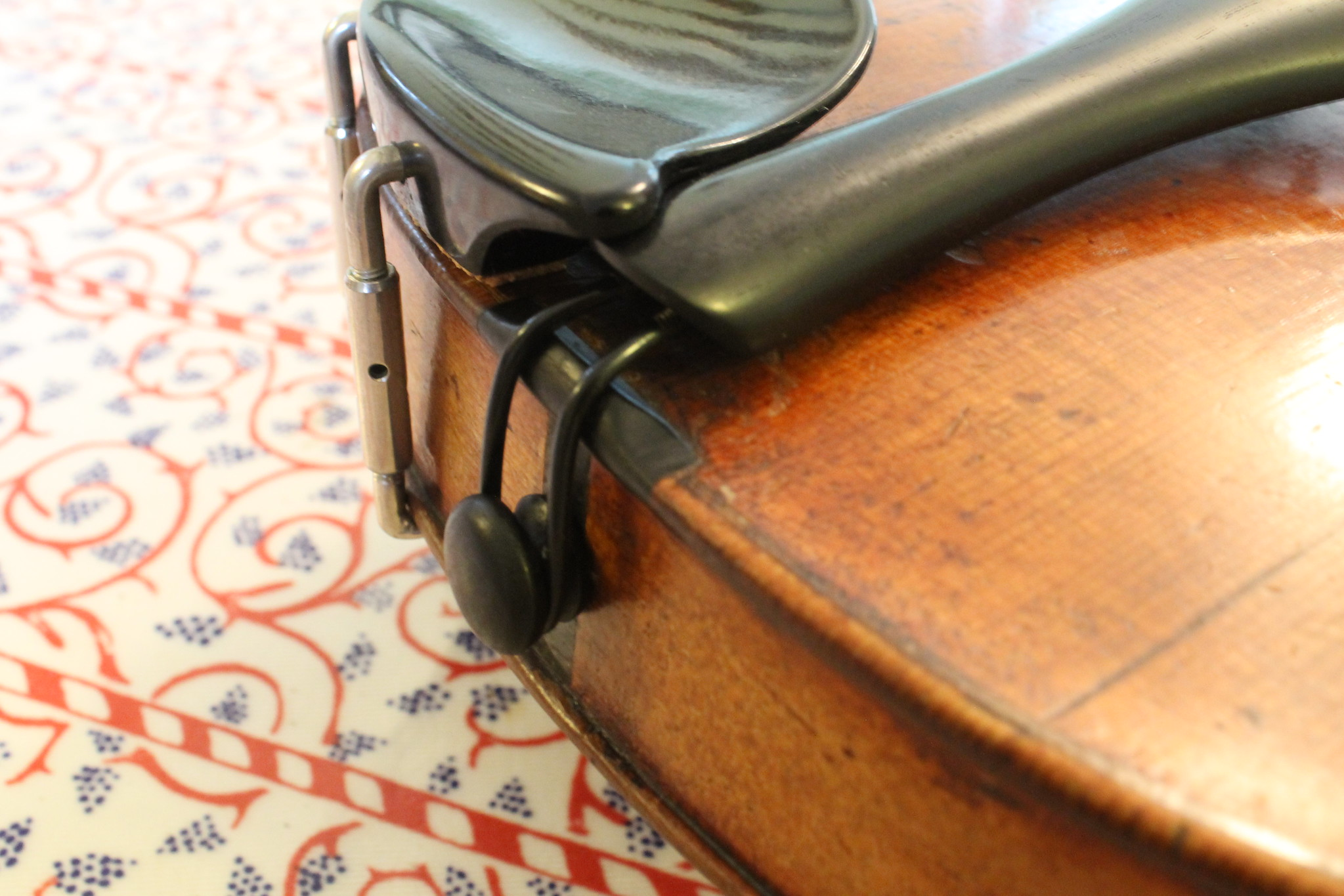 base of violin with clamp detail